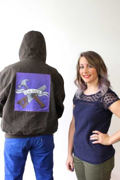 Artist Jenn Toby with jacket she painted for James Hooten
